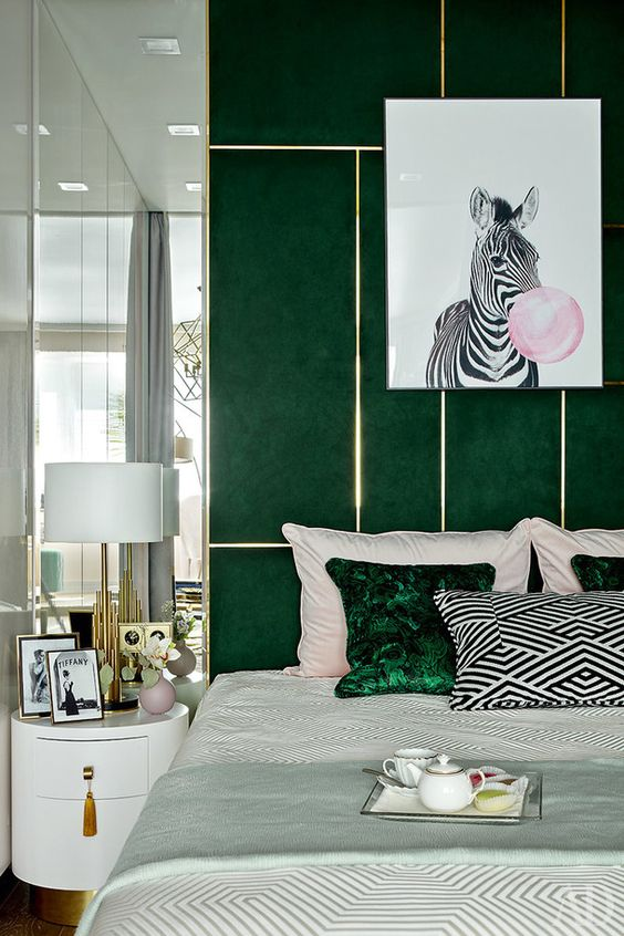 a catchy green and gold headboard and some matching pillows infuse this bedroom with color and make it bold