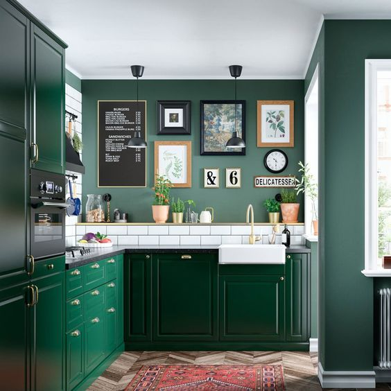 a chic green kitchen with green walls, bright emerald cabinets, a white subway tile backsplash for a fresh touch