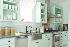 a fresh and beautiful mint green kitchen with black knobs, fixtures and much white to make it look more ethereal