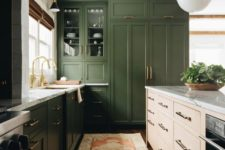 a modern farmhouse kitchen in grass green, with white marble countertops and gold touches here and there