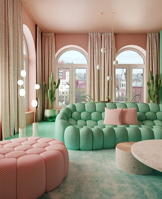 a pastel living room with pink walls, a ceiling and an ottoman plus a green wall and a green sofa looks dreamy
