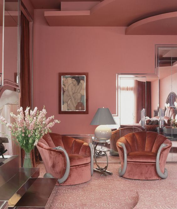 a refined living room with pink walls and a layered pink ceiling, a pink printed floor, gorgeous mauve chairs and touches of gold