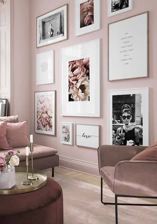 a romantic light pink living room with mauve furniture, a gorgeous glam gallery wall and touches of gold