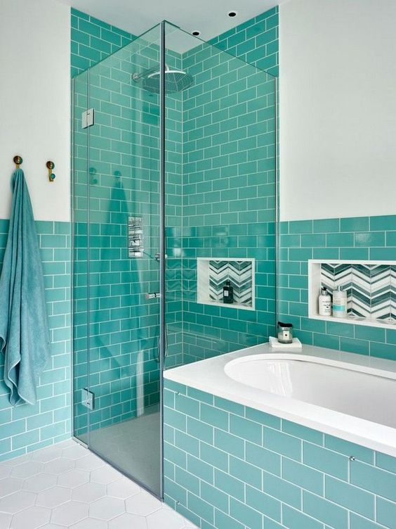 a stylish modern bathroom in white and with turquoise tiles looks contrasting and bright