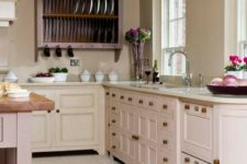 a vintage-inspired blush kitchen with lilac cabinets and a lilac kitchen island plus touches of brass is very chic
