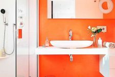 02 a bright and fresh modern bathroom with an orange accent wall and some more touches and all whites for a contrast is wow