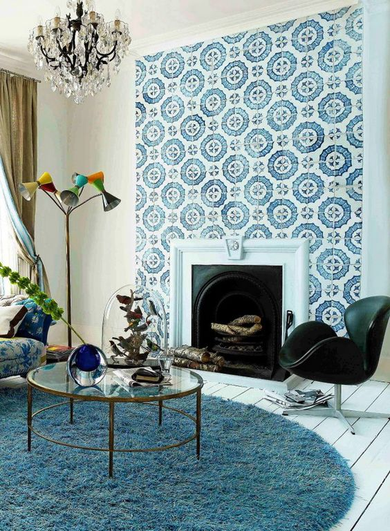 a built-in vintage fireplace clad with blue and white patterned tiles that stand out and make the space more refined