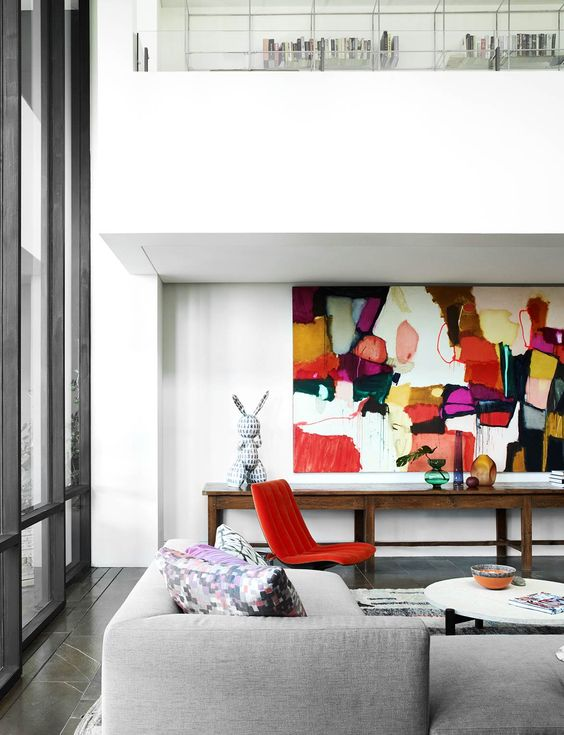 a gorgeous bright artwork brings much color and light to the space making it cooler and bolder