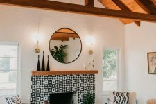 05 a bright monochromatic mid-century boho living room with a fireplace clad with black and white graphic tiles and a wooden mantel
