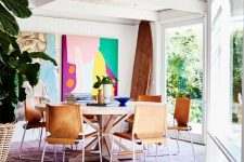 07 a mid-century modern dining space with super bright abstract artworks that create a mood here