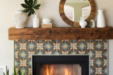 08 a built-in fireplace clad with colored patterned tiles around, with a rich stained wooden slab mantel