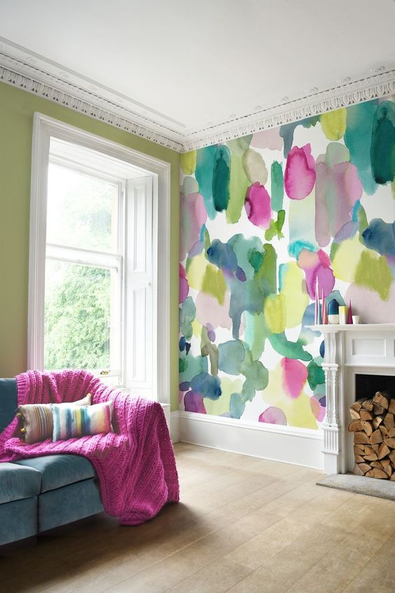 abstract super bold wallpaper to create an accent wall and some textiles to continue the decor theme