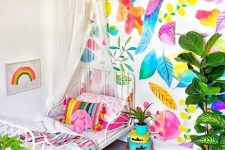 09 a neutral kid's room brightened up with bold wallpaper and matching textiles looks wow