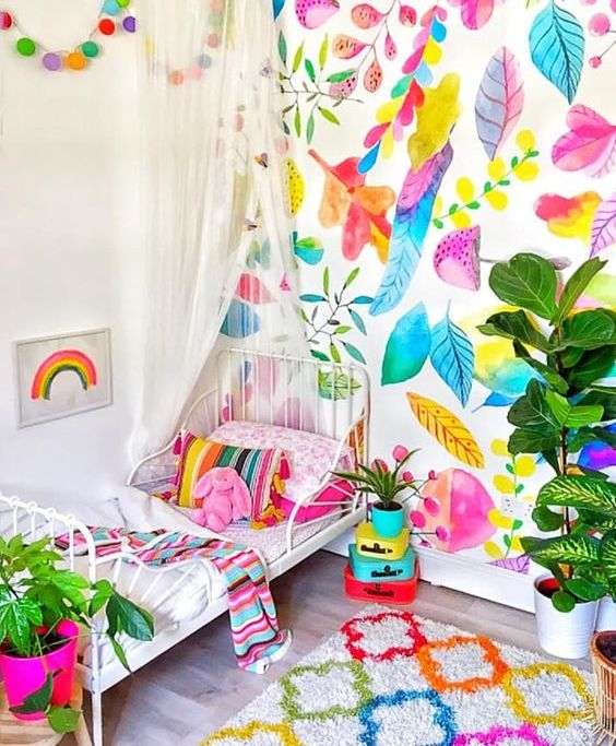 a neutral kid's room brightened up with bold wallpaper and matching textiles looks wow
