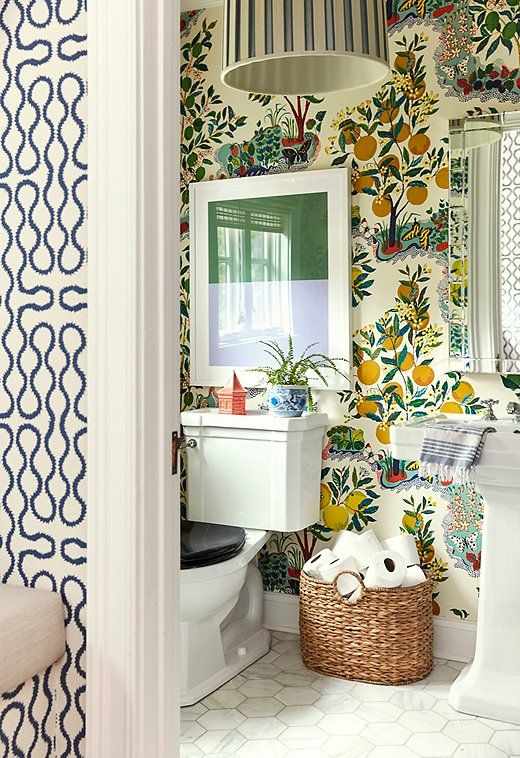 bright fruit wallpaper is a bold and trendy solution for a bathroom or a powder room and it brings color