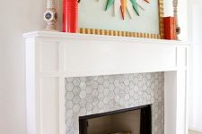 12 a built-in fireplace with marble hex tiles around it and on the floor and a stylish white frame and mantel