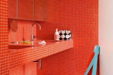 12 a super bold burnt orange bathroom fully clad with small scale tiles all over is ultimate