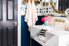 12 bold abstract wallpaper makes the powder room catchier and echoes with bright blue panels on the walls
