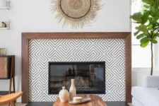 13 a built-in fireplace with monochromatic graphic tiles around it and a rich stained wooden frame