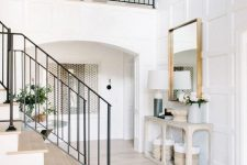 13 a stylish entryway lit up with chic neutral wood floors and the same cover on the stairs