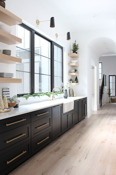 a stylish modern farmhouse kitchen with light wood floors and matching open shelves looks chic