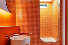 16 a super bright orange minimalist bathroom with white items to refresh the space and built-in lights to make it even brighter