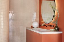 17 a creative bathroom in burnt orange and creamy, with tiles and matte surfaces and black wooden beams