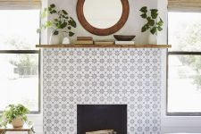 17 a faux fireplace with star print grey tiles around it and some stone on the floor looks very stylish