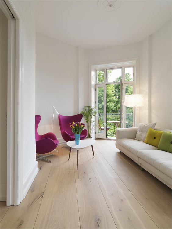 light wooden floors here add warmth and interest to the space and help to brighten it up