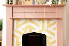 18 a faux fireplace with yellow and white graphic tiles around it and a peachy pink frame and mantel with a qurky gallery wall