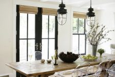 19 a cozy rustic dining space with acrylic chairs that help natural light go through and don't make the space dark