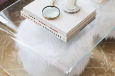 20 a sheer acrylic coffee table is a nice addition to a modern living room, it looks glam and chic