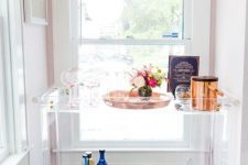 23 a lucite bar cart seems airy and floating in the air, it's perfect for a small nook and doesn't look bulky