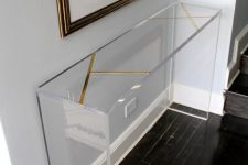 25 a brass inlay lucite console will look very lightweight even in a dark entryway