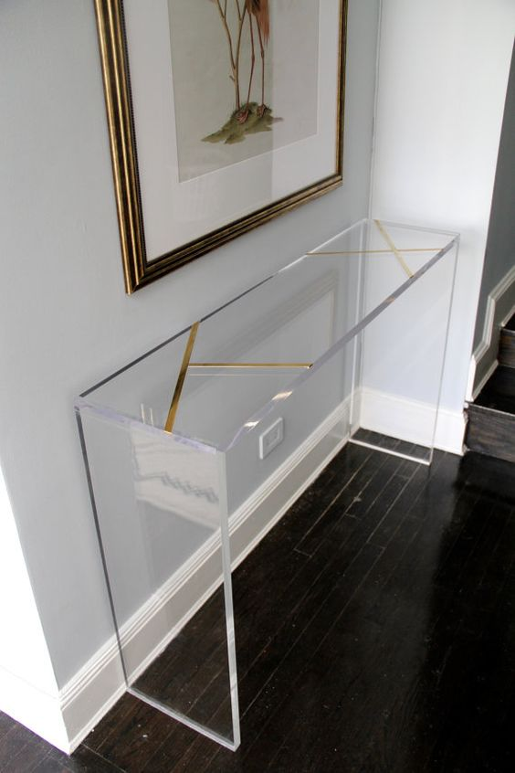 a brass inlay lucite console will look very lightweight even in a dark entryway