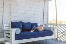a summer front porch with a daybed