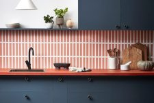 a cool grey and orange color scheme for a kitchen decor