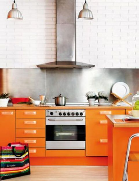 a modern bright orange kitchen design