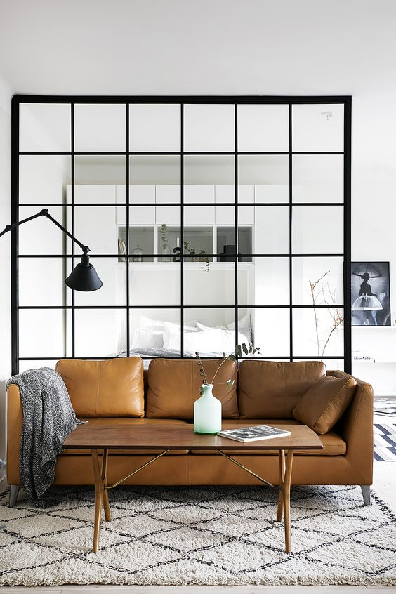 a brown leather Stockholm sofa by IKEA is a stylish statement for a modern living room
