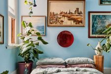 a cute bedroom with a gallery wall above the bed