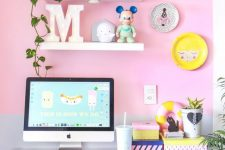 a cheerful hot pink home office nook with a bright accent wall, a hot pink chair, a fun gallery wall and pink accessories