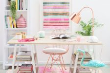 a colorful and cheerful home office with bright printed rug, a striped artwork and pink accessories plus a turquoise flamingo