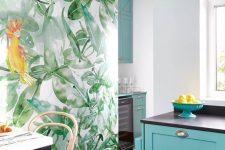 a colorful kitchen with a tropical mural, turquoise cabinets, dark appliances and woven stools looks very tropical-like