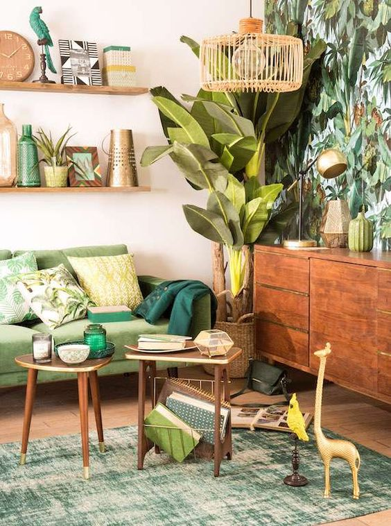 a colorful tropical living room with a tropical leaf wall, a green sofa, wooden furniture, woven and rattan elements