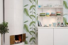 a creative tropical kitchen with tropical wallpaper, white minimalist cabinets, a intage hearth and a printed rug