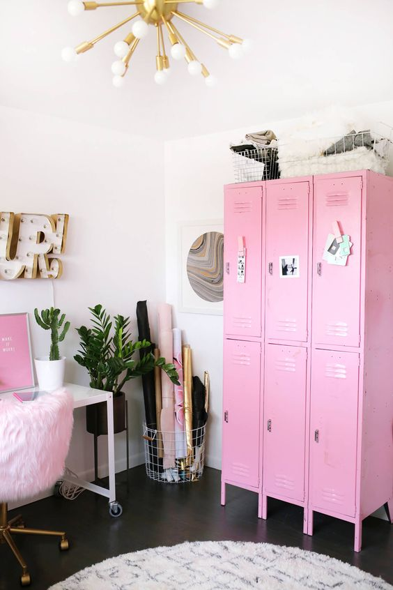 a glam girlish home office in neutrals, with a hot pink storage piece, artworks and touches of gold for a shiny touch
