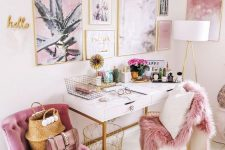 a glam girlish home office infused with pink – a pink chair, faux fur, artworks and gold accessories for more chic
