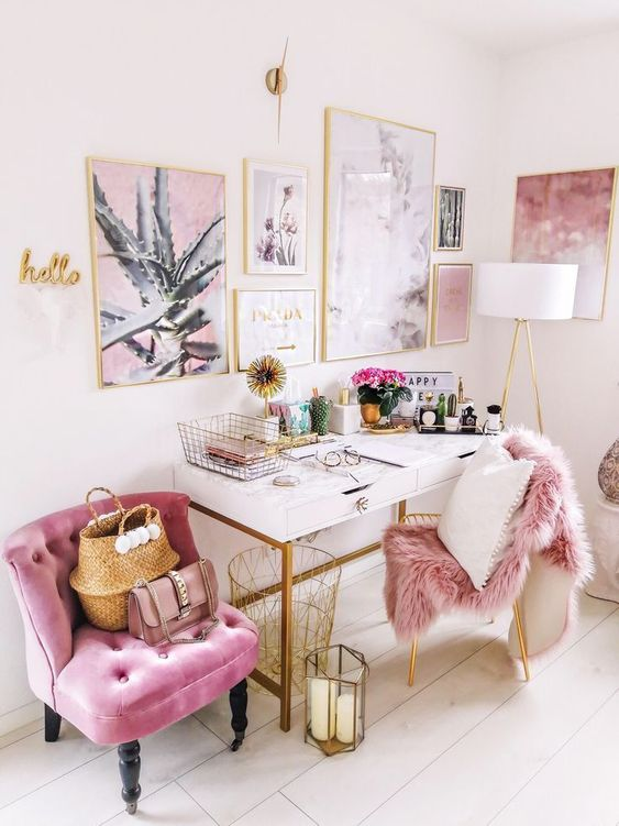 a glam girlish home office infused with pink   a pink chair, faux fur, artworks and gold accessories for more chic