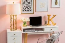 a glam home office with a light pink wall, white and clear furniture and a fun and glam gallery wall for inspiration