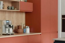 a minimalist terra cotta kitchen with wooden countertops and a backsplash looks bold and very eye-catchy